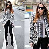 A mismatched black-and-white blazer and blouse combination adds interest to a simple black skinny jean on bottom.