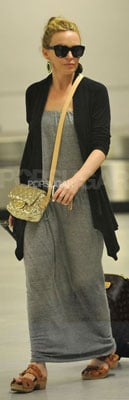 Kylie Minogue Wears Long Gray Dress and Gold Bag