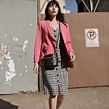 A Bright Pink Blazer and Plaid Dress