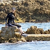 Madonna sat on a rock by the shore.