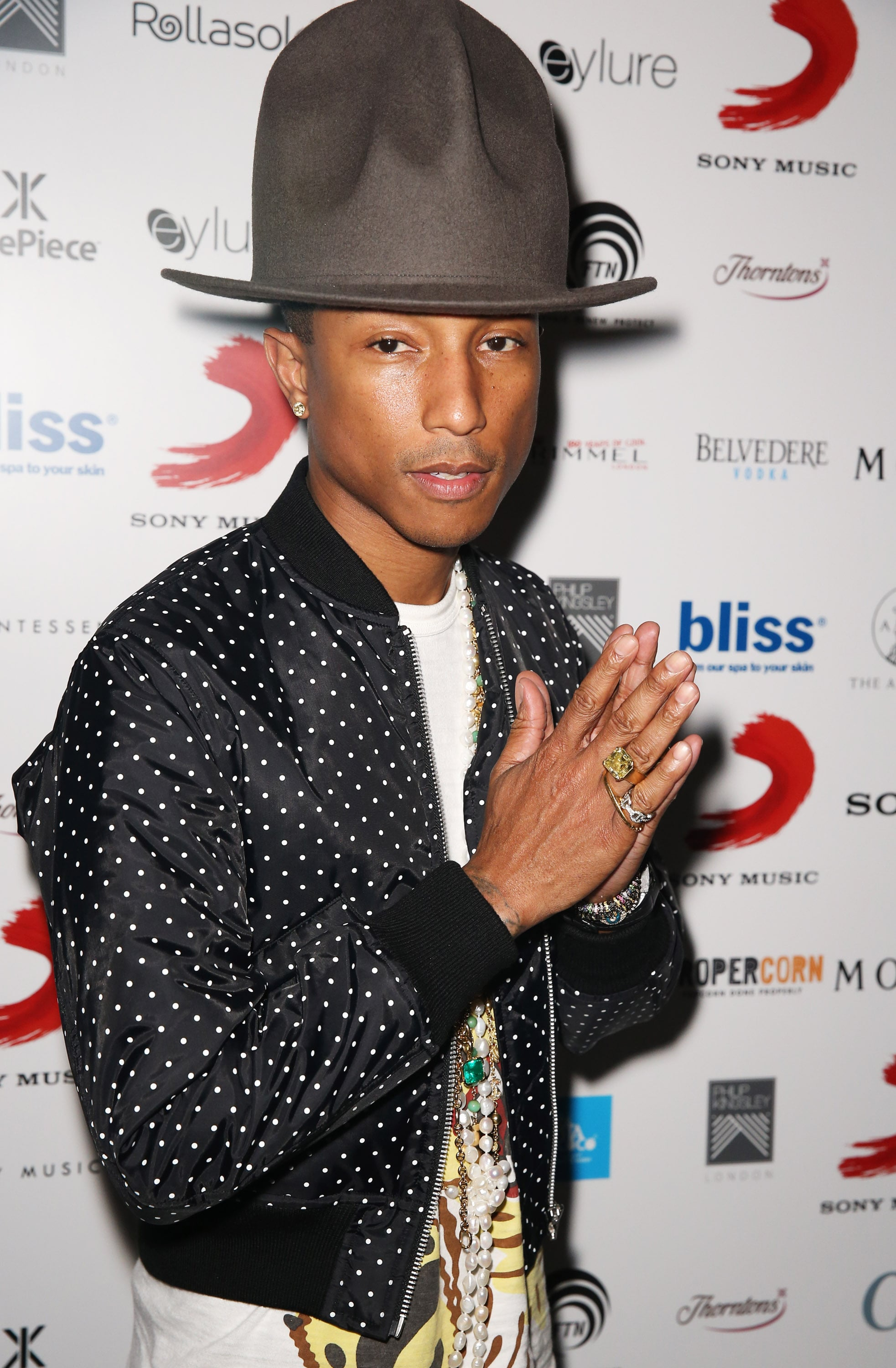 Pharrell and the hat let loose when they stopped by an afterparty for the Brit Awards.