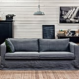 Pictured:  Bemz cover for Karlstad three seater sofa loose fit urban style in medium grey rosendal pure washed linen Cushion cover in sybary charcoal grey