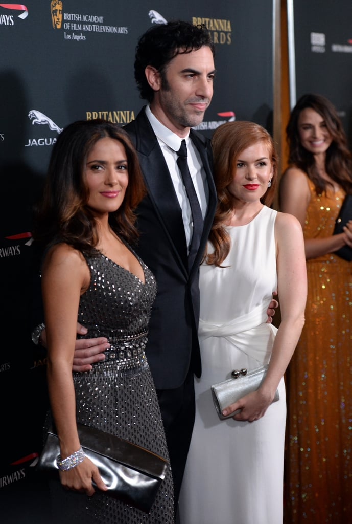 Sacha Baron Cohen posed with Salma Hayek and his wife, Isla Fisher, on the red carpet.
