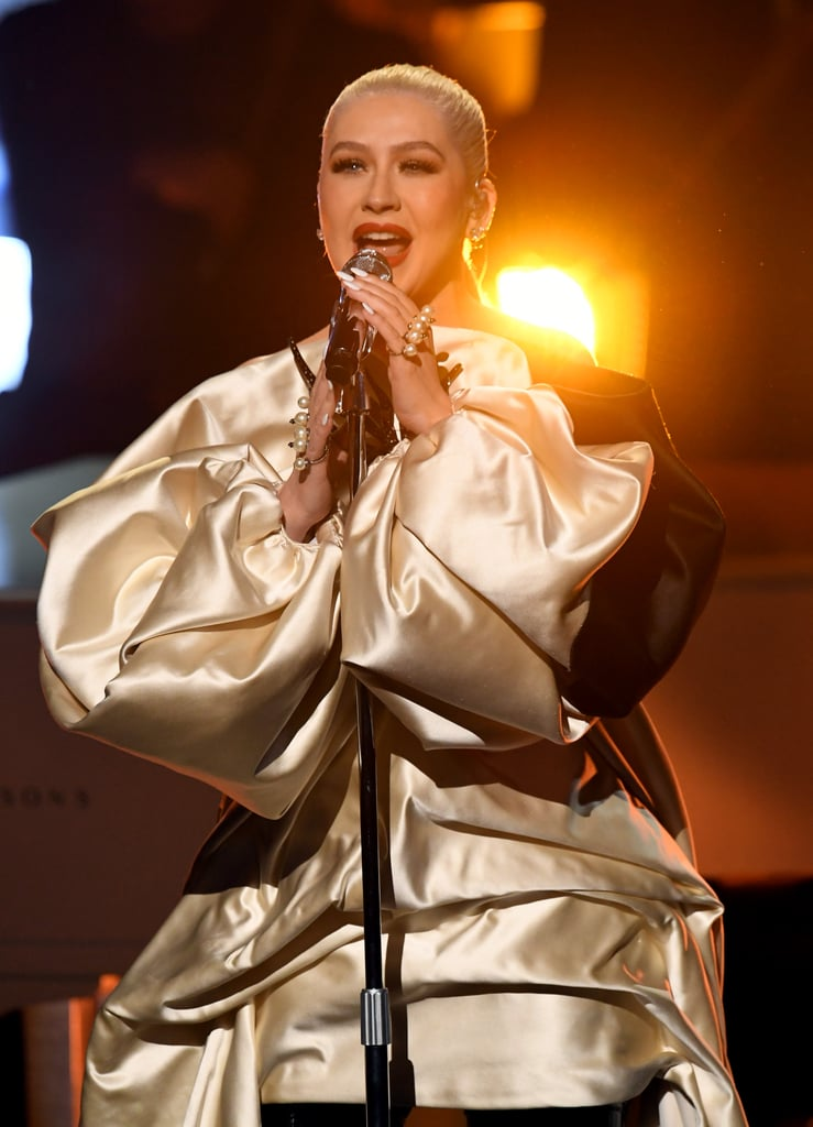 """A Great Big World and Christina Aguilera made an iconic return to the American Music Awards on Sunday. After performing their Grammy-winning hit """"Say Something"""" during the award show in 2013, the pop duo and singer returned to the stage to sing their new song """"Fall on Me."""" As Ian Axel played the piano, Aguilera moved us to tears with her incredible vocals. Grab some tissues and watch their heartfelt performance above."""