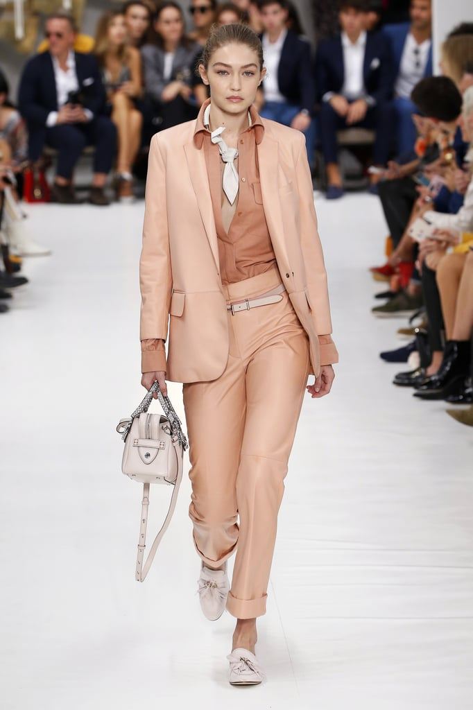 Gigi's Second Tod's Look Was a Salmon Colored Suit With White Accessories
