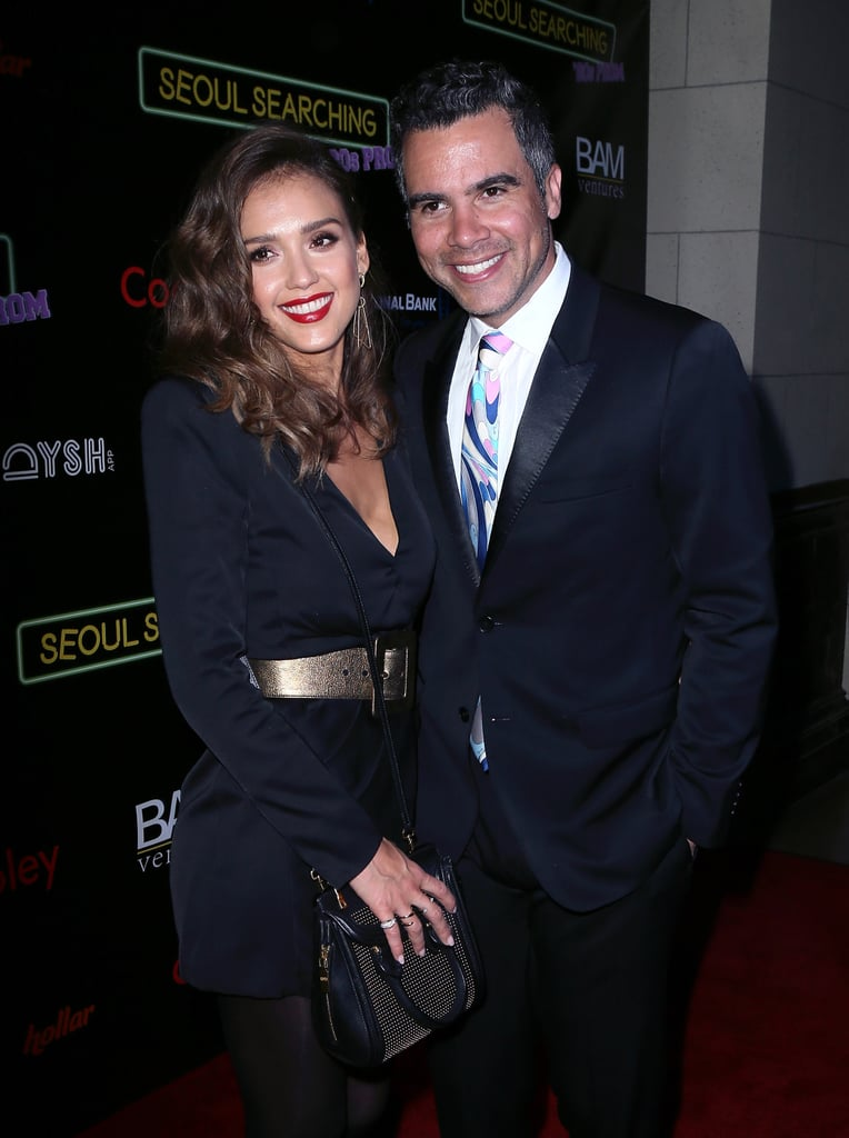 """Jessica Alba and Cash Warren stuck together while making their way down the red carpet in LA on Friday night. The couple attended the premiere of Seoul Searching, a coming-of-age comedy set in 1980s Korea, and were all smiles as they posed for photos and checked out something on Jessica's cell phone. It's just the latest in a series of sweet moments between Cash and Jessica, who have been married for eight years and are parents to two adorable daughters, Honor and Haven.  While Jessica has made a name for herself as an actress, mum, and entrepreneur, she hasn't always been comfortable in the limelight. In a recent InStyle interview, Jessica admitted to being """"very uncomfortable"""" with her sex-symbol status, and she """"sort of went through a life crisis"""" at 25, saying, """"I was like, 'This isn't what I set out to be. I'm so much more than this, but I don't know how not to be a sex symbol.'"""""""