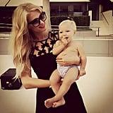 "Paris Hilton posed with her adorable neighbor, saying, ""I love babies!"" Source: Instagram user parishilton"