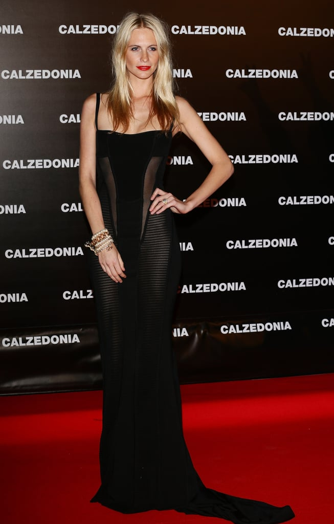 Poppy Delevingne smoldered on the red carpet in a body-hugging, sheer-inset gown for an event in Italy.