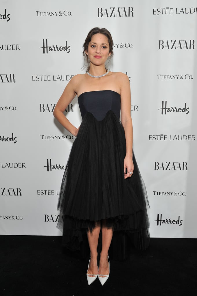 Marion Cotillard chose a strapless high-low dress from the Christian Dior Spring 2013 collection and paired it with white pumps at the Women of the Year Awards in London.