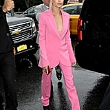 Hailey wore a Barbie pink suit to the Carolina Herrera show in NYC in September.