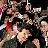 Tom Cruise took photos with fans in Japan.