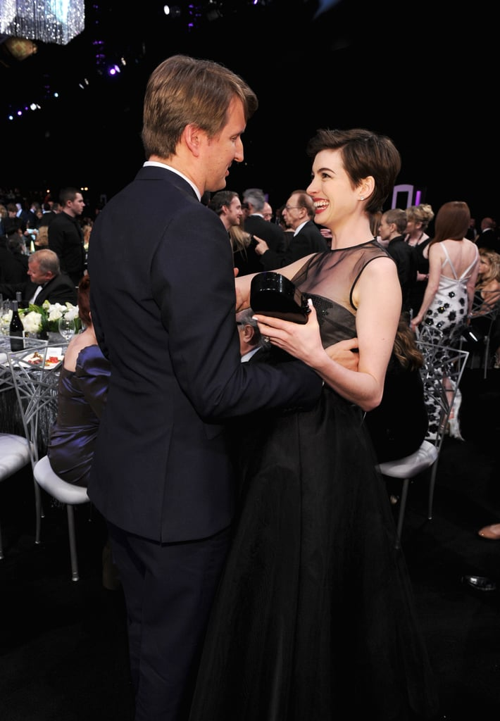 Anne Hathaway hugged Tom Hooper at the SAG Awards.