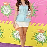 Gomez hit the purple carpet at the 2013 Kids' Choice Awards working a sweet girlie combo: light blue peplum top by Oscar de la Renta and short white shorts. She accessorized her party style with snakeskin Gucci heels and a pastel Diane von Furstenberg clutch.