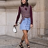 Freshen up a smart top and casual denim skirt combo.