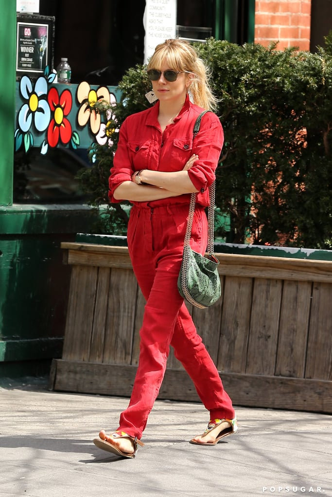 Sienna Miller wore a red jumpsuit.