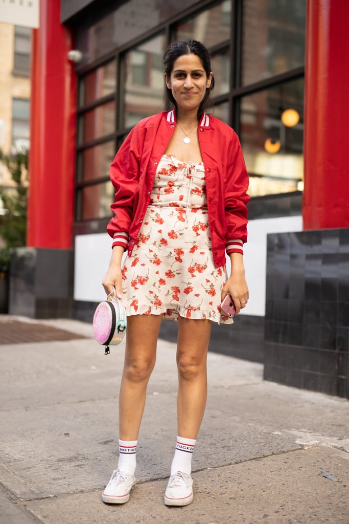 Add a little coverage with a bomber jacket over your favourite summer dress, and finish with smart, walkable tennis shoes.