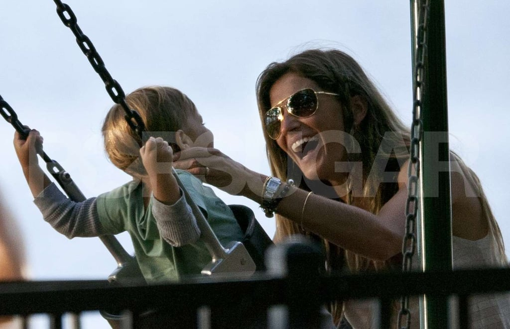 Gisele smiled big at baby Ben in a swing.