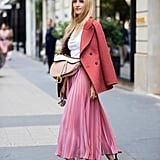 Style a Logo Pair With a Pleated Skirt and Blazer