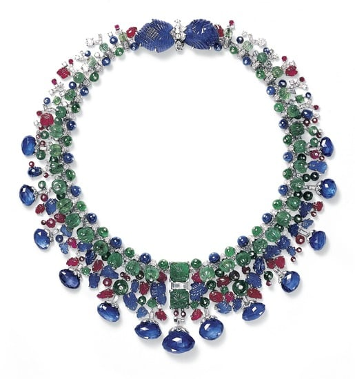 The jewels alluded to in the film are represented by the Tutti Frutti necklace, made to order for Daisy Fellowes, the daughter of the Duc Descaze and Isabella Singer (heiress to the Singer sewing machine fortune). A Parisian socialite who became Paris correspondent to Harper's Bazaar from 1933 to 1935, Fellowes's Tutti Frutti necklace was comprised of 13 sapphires, two leaf-shaped sapphires, and an array of emerald and ruby beads. This Tutti Frutti style became iconic to Cartier and was inspired by Jacques Cartier's trips to India.