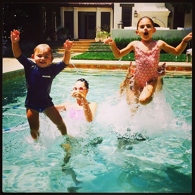 Alessandra Ambrosio and Jamie Mazur played in the pool with their kids, Anja and Noah. Source: Instagram user alessandraambrosio