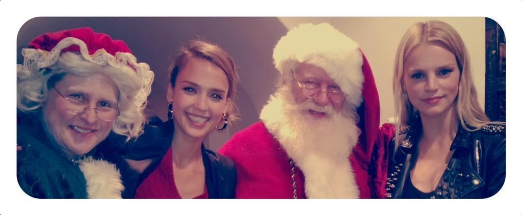 Jessica Alba posed for Christmas photos with Santa, Mrs. Claus, and friend Kelly Sawyer. Source: Twitter user jessicaalba