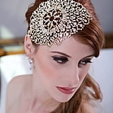 For engaged ladies who don't want to wear veils, this lacy crystal headpiece ($78) is a gorgeous alternative. It is available in rose gold or yellow gold, and it features sparkly crystals with an intricate embroidery pattern.