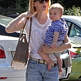 January Jones carried a purse and Xander Jones in Pasadena.