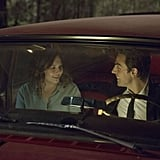 Finally, here she is in a car with Johnny.