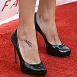 The actress is a fan of the foot tattoo; she's got a shooting star on her right, and a tiny, adorable peace sign on her left.