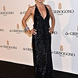 Heidi Klum struck a pose in a slinky black Roberto Cavalli gown at the de Grisogono fete.
