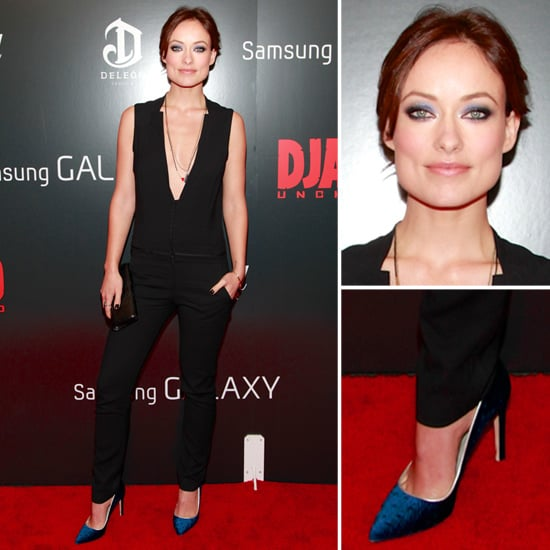 At the NYC screening of Django Unchained Olivia paired a plunging A.L.C jumpsuit ($695) with a black crocodile clutch, then slipped on a pair of blue velvet Gio Diev pumps, a few pendant necklaces, and shimmering violet eye shadow for a pop of flair. 9408262