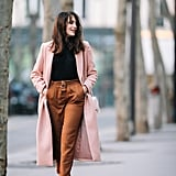A Long Pink Coat, a Turtleneck, Cigarette Trousers, and Heels