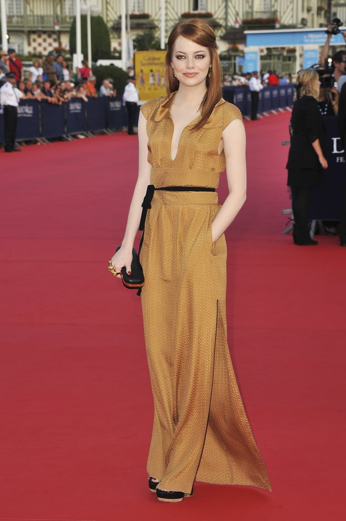 Emma shined on the red carpet in this mustard-colored Roland Mouret dress. She looked easy and comfortable in the silhouette, and accessorized with sleek black pieces.