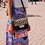 Amid all the matching sets, a little print-mixing was a refreshing change of pace. This leopard-print Madewell bag worked wonderfully with her patchwork skirt.
