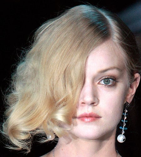 Armani: Side-Swept Curls