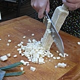 Rotate the cob in your hand and continue to cut all four sides of kernels off.