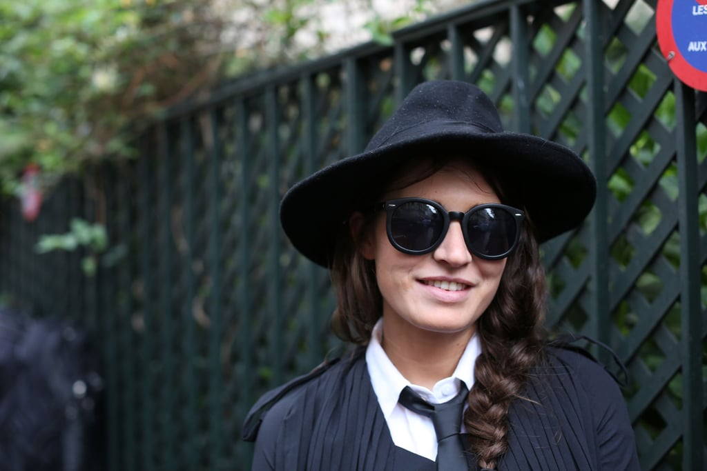 Borrowed-from-the-boys style complete with a wide-brim hat and oversize shades.