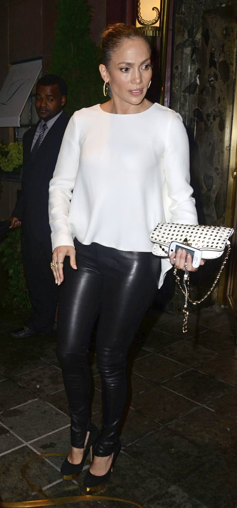 Jennifer Lopez wore a white sweater and leather pants.