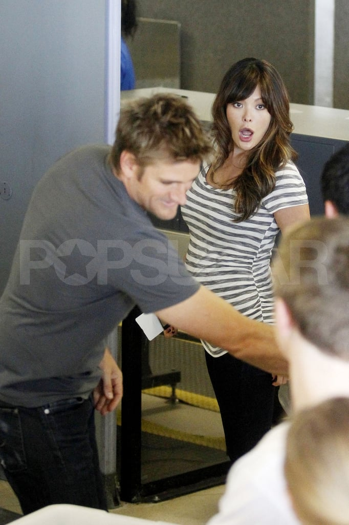 Pregnant Lindsay Price going through LAX security with Curtis Stone.