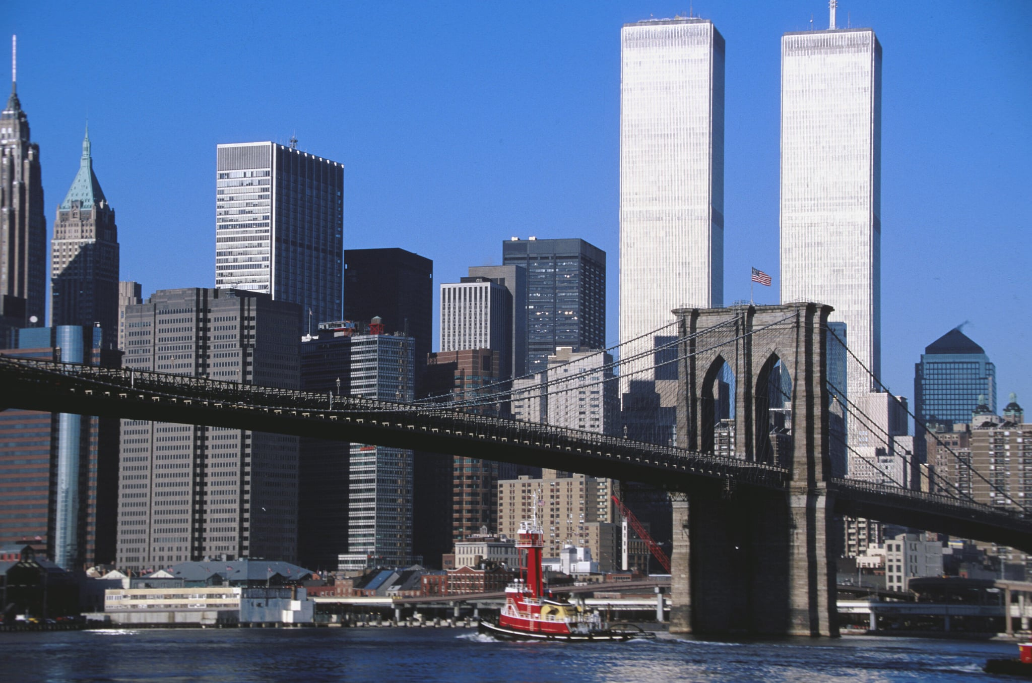 2001: Brooklyn bridge in the downtown of Manhattan and the World Trade Centre towers. (Photo by michel Setboun/Corbis via Getty Images)