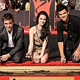 Kristen Stewart, Robert Pattinson, and Taylor Lautner signed their names in wet cement.