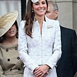 She flashed a big grin while standing on the balcony, all smiles as she stood beside the rest of the royal family.