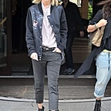 Anja Rubik brought her fashion-forward ways to Warsaw wearing a sporty varsity jacket with lace-up denim and spiked booties.