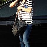 Courteney Cox chatted on the phone.