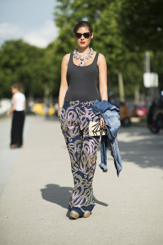 Steal a page from this showgoer's styling manual and add interest to a basic tank with statement pants and heavy jewels. Source: Le 21ème | Adam Katz Sinding