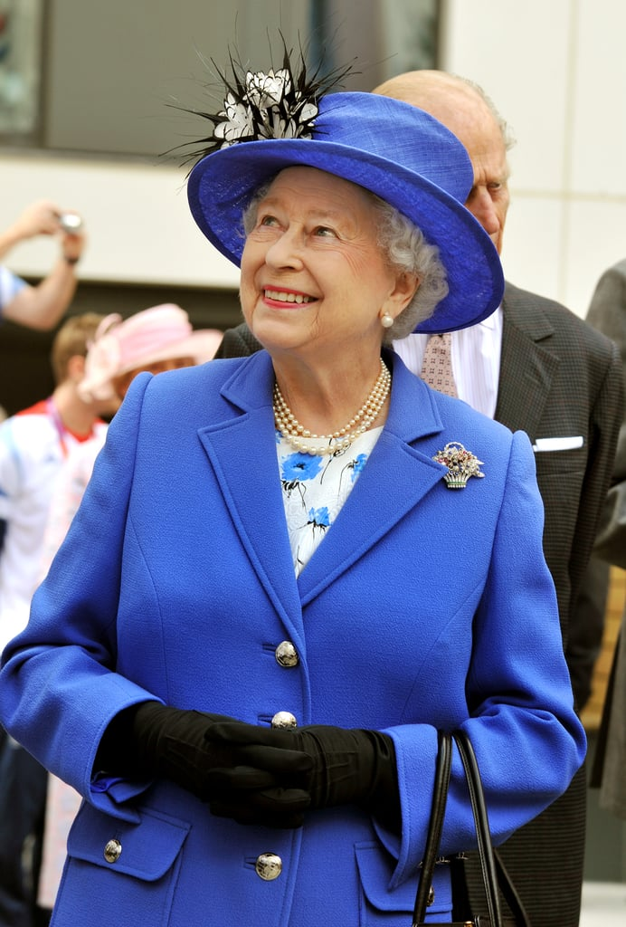 The queen smiled on day one of the London Olympics.