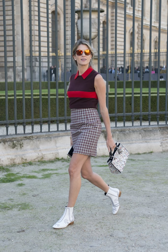 Opt for a preppy look by pairing a checkered skirt with a collared shirt.