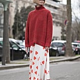 Wear a Cozy Red Sweater With a Printed Skirt