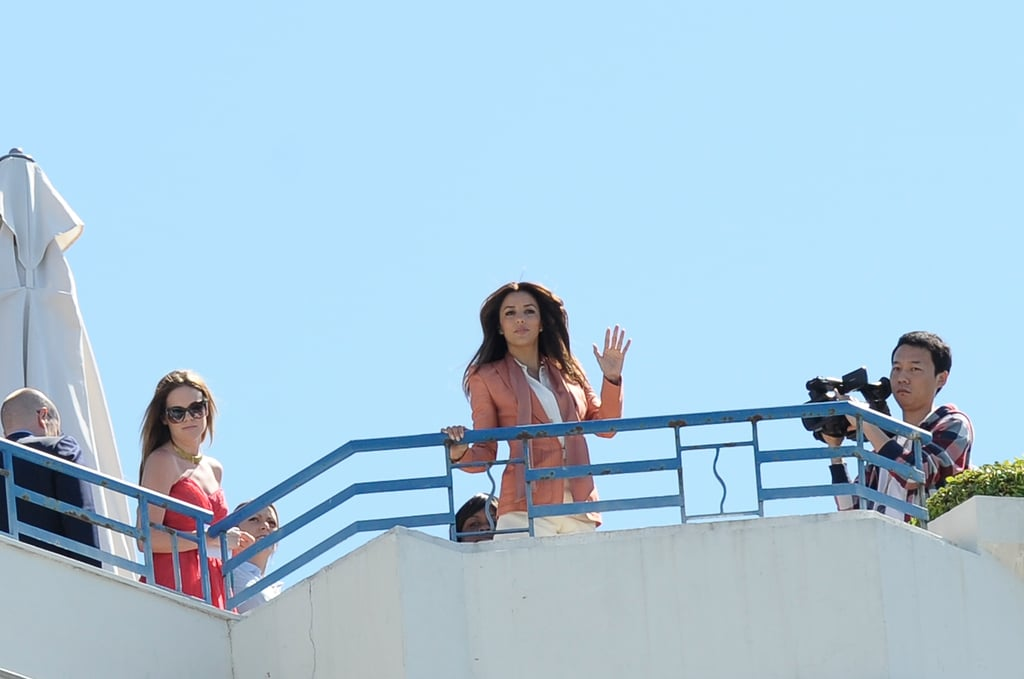 Eva Longoria gave a wave as she was photographed on the top of a hotel in Cannes.