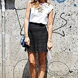 A flirty lace skirt got a cool accompaniment with a printed tee and mirrored shades.